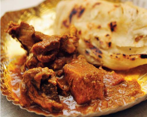 Handmade Kerala Porotta with Chicken Curry